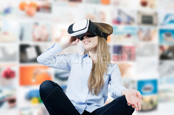 Woman wears virtual reality glasses with smartphone inside. Stock photo © simpson33