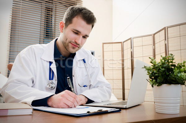 Doctor gynecologist working in office. Stock photo © simpson33