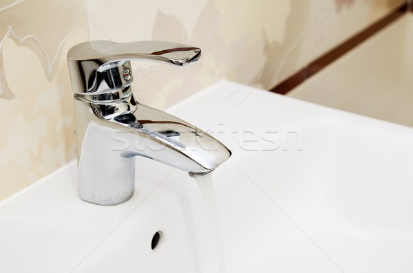 Faucet in bathtoom. Utilities water bill cost rise wash compositon Stock photo © simpson33