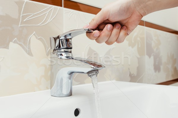 Man unscrew the faucet in the bathroom. Stock photo © simpson33