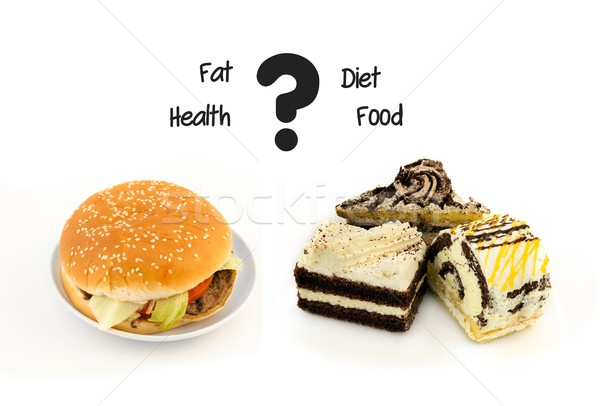 Unhealthy food. Cake with cream and fastfood hamburger Stock photo © simpson33