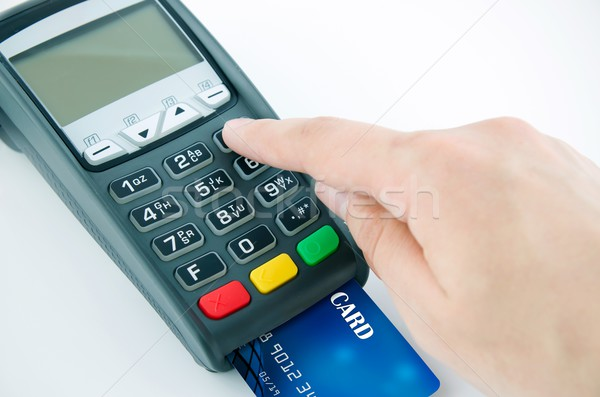 Man using payment terminal keypad, enter personal identyfication Stock photo © simpson33