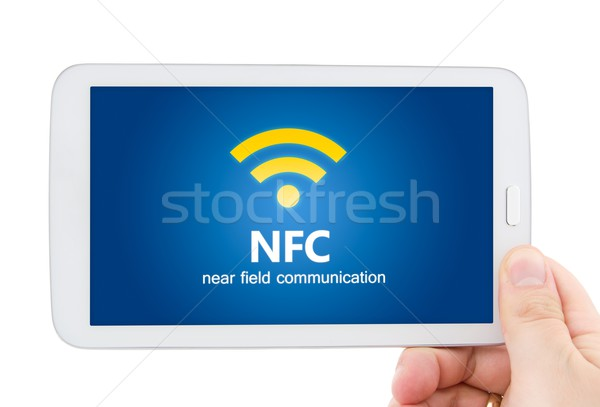 Hand holding tablet with NFC. Technology of wireless payment met Stock photo © simpson33
