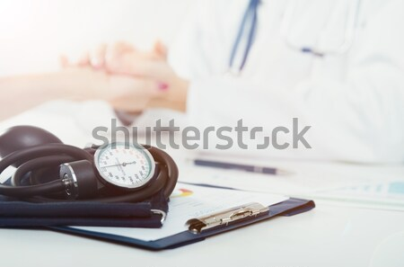 Doctor uses a sphygmomanometer  Stock photo © simpson33