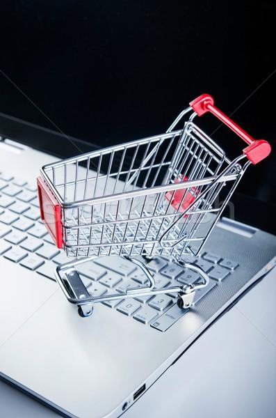 Internet shopping concept. Basket on laptop keyboard Stock photo © simpson33
