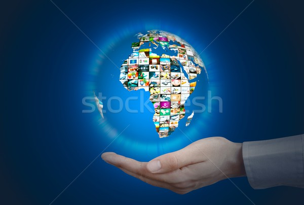 Television broadcast multimedia sphere. World globe on hand Stock photo © simpson33