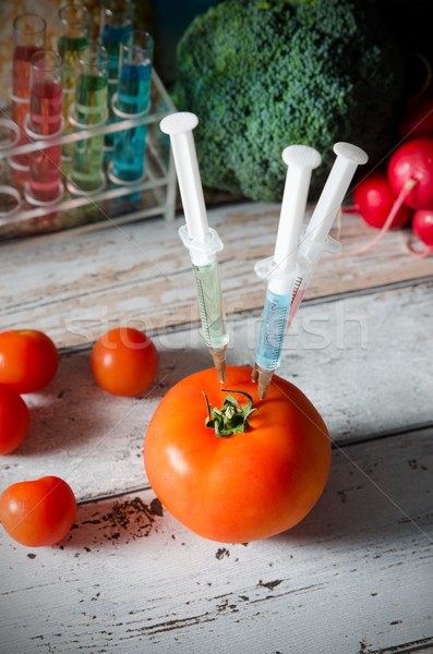 Three syringes in tomato. Genetically modified food concept. Stock photo © simpson33