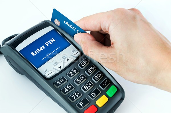 Hand with credit card swipe through terminal for sale. Enter PIN Stock photo © simpson33