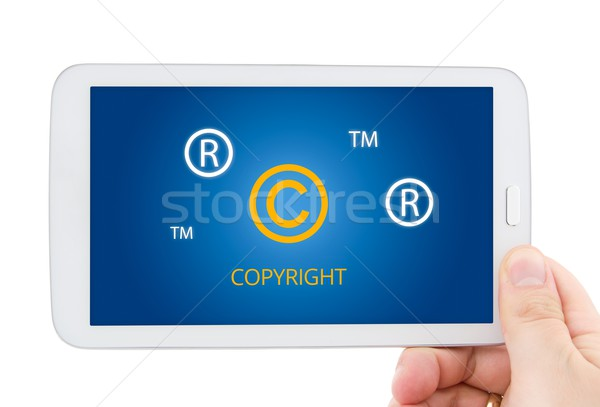 Copyright, registered, trademark symbols on tablet pc display Stock photo © simpson33