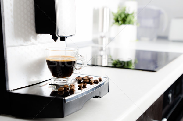 Professional home coffee maker in modern kitchen Stock photo © simpson33