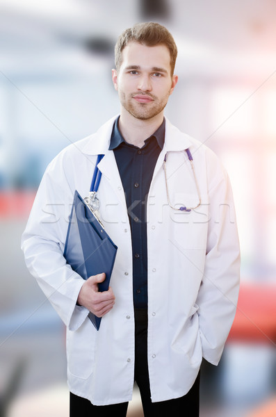 Handsome young doctor in office Stock photo © simpson33