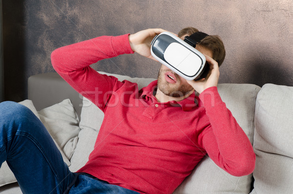 Man wears virtual reality glasses with smartphone inside Stock photo © simpson33