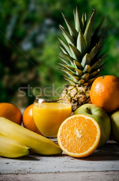 Lot of fresh fruits on wooden background Stock photo © simpson33