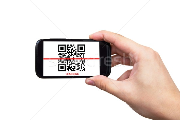 Smartphone scanning QR code Stock photo © simpson33