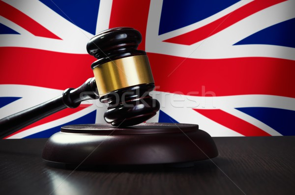 Wooden gavel with United Kingdom flag in background Stock photo © simpson33