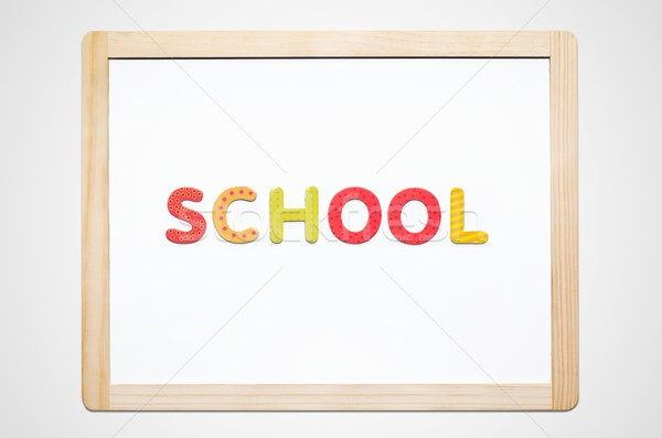 Hand put the word School on magnetic board Stock photo © simpson33