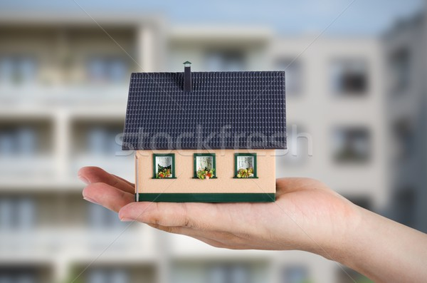 Replace flat to your own house. Hand holding miniature Stock photo © simpson33