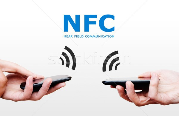 Two mobile phones with NFC payment technology. Near field commun Stock photo © simpson33