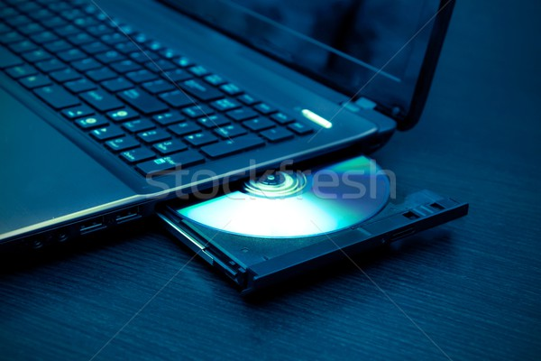 Laptop with open CD - DVD drive. Abstract light composition Stock photo © simpson33