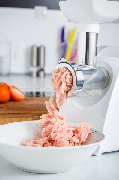 Grinder with minced meat in modern kitchen Stock photo © simpson33