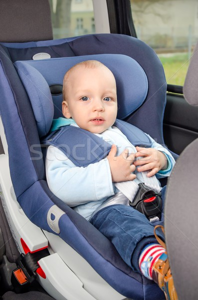 Cute boy sitting in the car seat  Stock photo © simpson33
