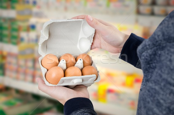 Man holding egg box in supermarket Stock photo © simpson33