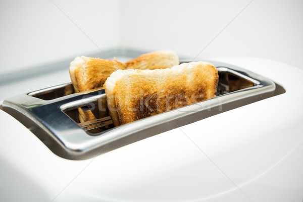 Toaster with bread slices on white background Stock photo © simpson33