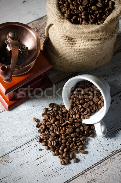 Coffee grain spill from a cup. Jute bag of roasted beans and mil Stock photo © simpson33