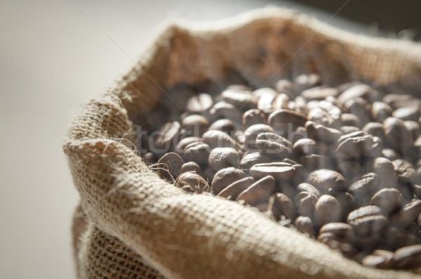 Close up coffee beans in jute bag Stock photo © simpson33
