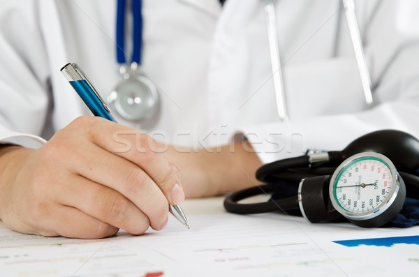 Doctor working at his desk in the hospital Stock photo © simpson33