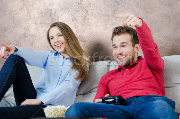 Couple enjoys free time and playing video games Stock photo © simpson33