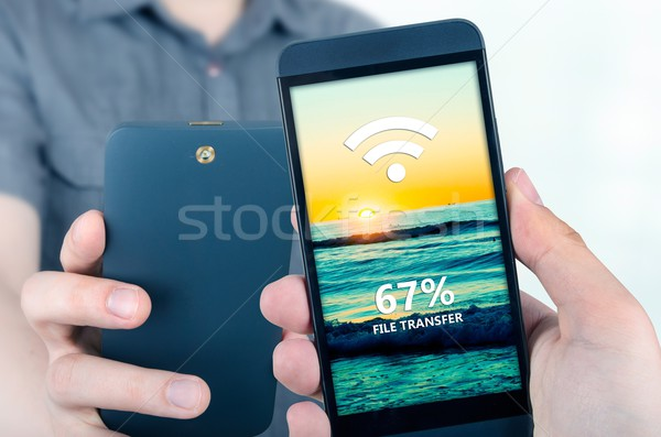 Hand holding smartphone with NFC technology - near field communi Stock photo © simpson33