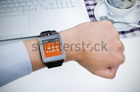 New e-mail notification on smart watch connected to smart phone Stock photo © simpson33