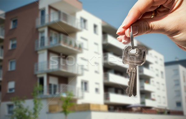Woman hand holding keys with to house Stock photo © simpson33