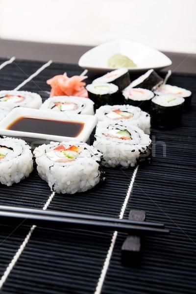 Stock photo: Sushi set on black bamboo mat