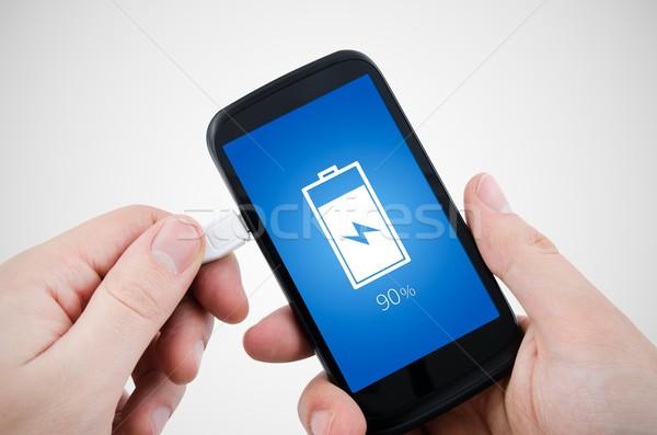 Man using phone charger via USB Stock photo © simpson33