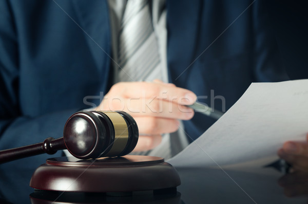 Wooden gavel, working lawyer in background Stock photo © simpson33