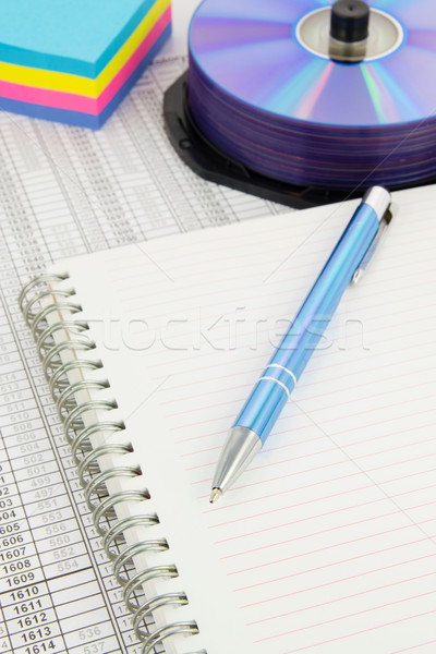 Pen on sheet of a copybook. Color paper, compact discs in background Stock photo © simpson33