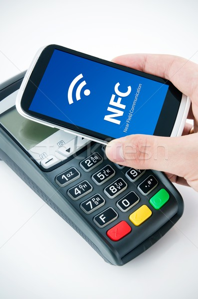 Stock photo: Contactless payment card with NFC chip in smart phone