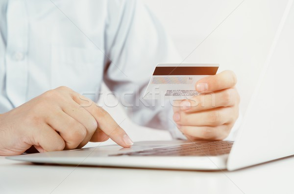 Férfi laptop hitelkártya internetes vásárlás internet nap Stock fotó © simpson33