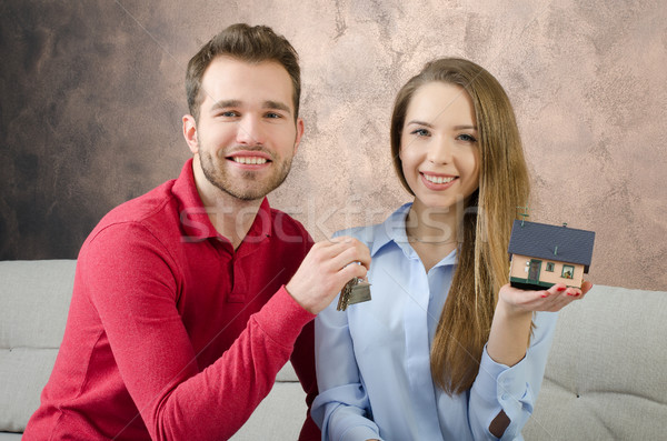Young couple enjoys the purchase of own home Stock photo © simpson33