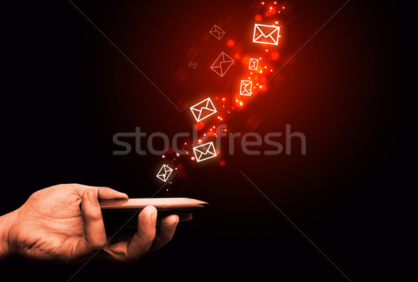 Abstract, touching mobile phone, flying envelopes, fire effect Stock photo © simpson33