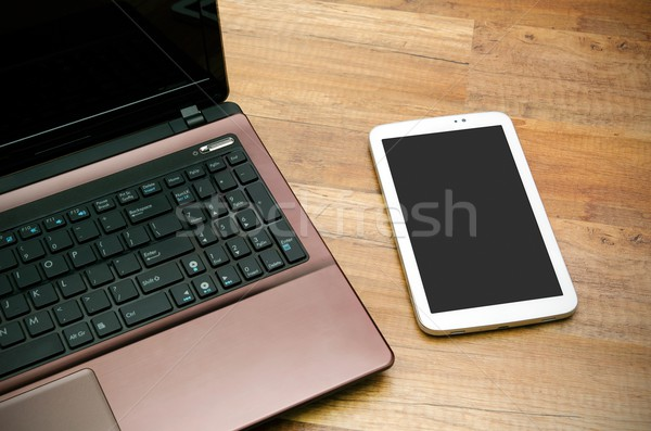 Cell phone and tablet od wooden background Stock photo © simpson33