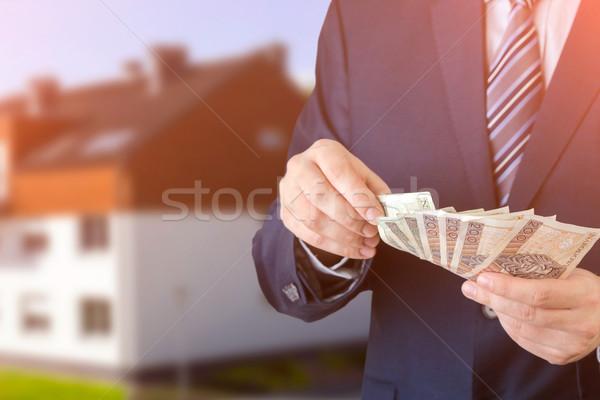 Empresario dinero préstamo casa efectivo Foto stock © simpson33