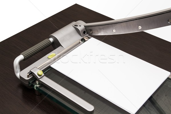 Sheet of paper in the guillotine Stock photo © simpson33