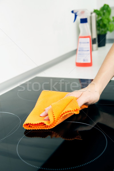 Hand cleaning induction stove Stock photo © simpson33