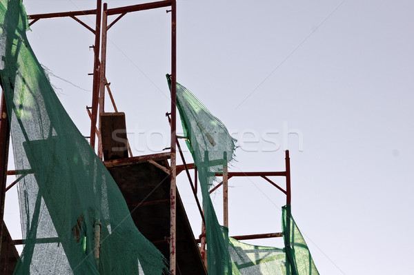 Stock photo: torn debris netting scaffold