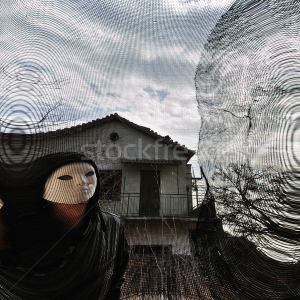 masked evil figure behind threaded window Stock photo © sirylok