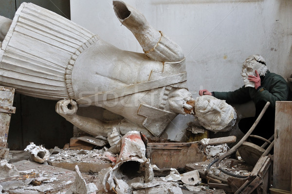 broken statue and man with plaster mask fragment Stock photo © sirylok