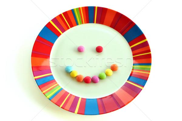 Szczęśliwy posiłek uśmiechnięta twarz candy kolorowy tablicy Zdjęcia stock © sirylok